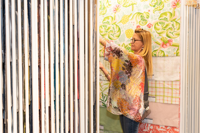 Jamie Klein of Expressive Design flips through new product displays.