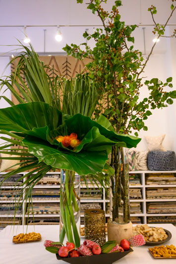 The showroom was decorated with floral arrangements by Trifon Glynos Design.
