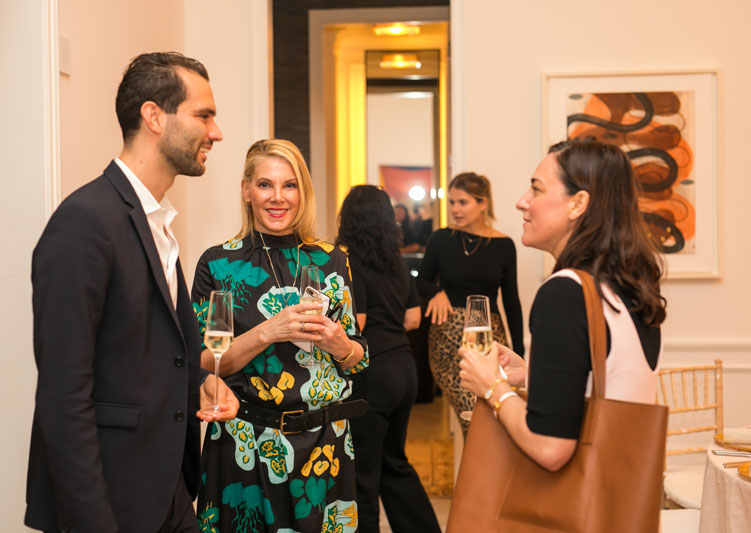 Élitis's Olivier Thienpont and Elle Decor's Karen Marx chatted with Paris Forino during cocktail hour