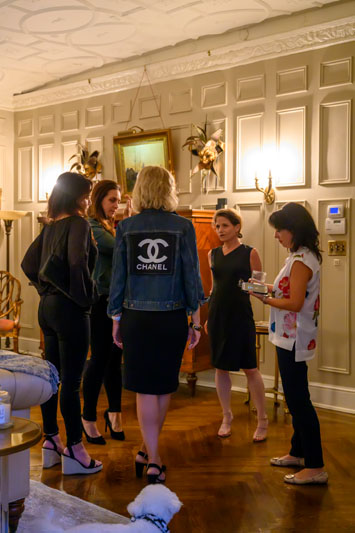Twelve designers attended the intimate dinner, including Nancy Melius (second from right) and Eryn Oruncak (right).