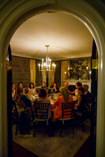 Guests sit for an intimate dinner.