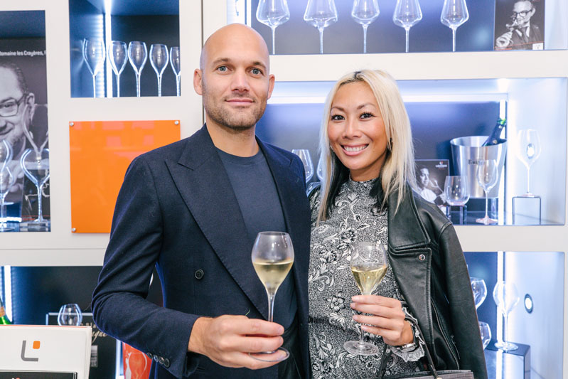 Kyle Ridington and Olivia Wong toast to Kiyasa Group's 10th anniversary.