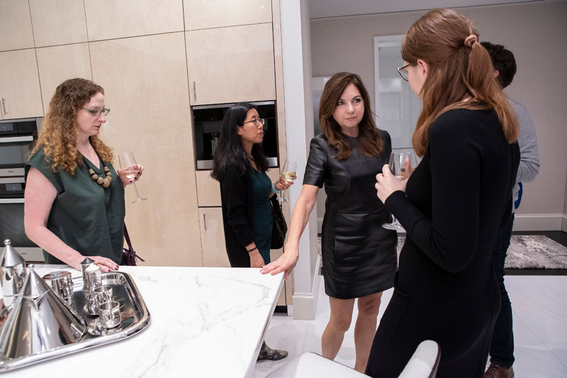 Lauren Rottet chats with guests about the kitchen schemes.