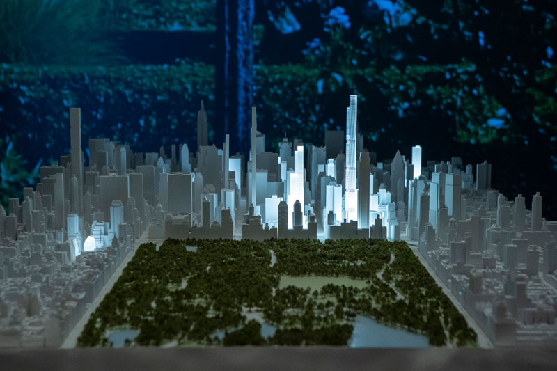 Extell buildings light up a model of the cityscape.