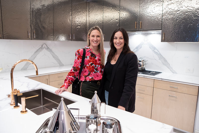 Jane Francisco and Laurie Jennings in the kitchen scheme with hammered metal upper cabinets
