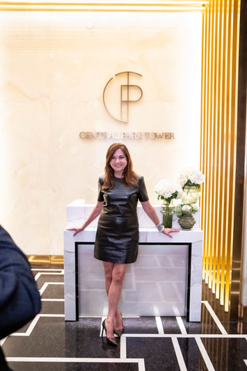 Lauren Rottet in the lobby of Central Park Tower sales center, which evokes the final design.