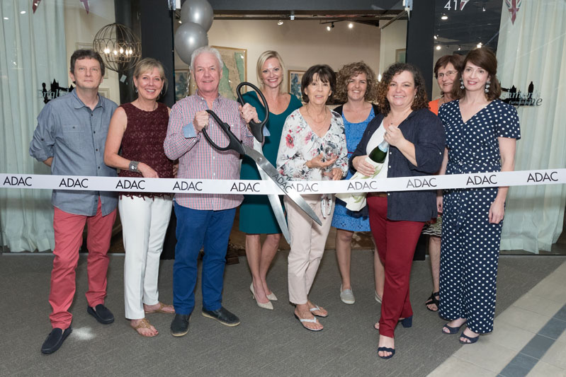 A ribbon cutting at the opening party for  Englishman's Fine Furnishings