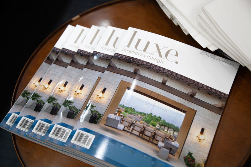 Copies of Luxe Interiors + Design on display