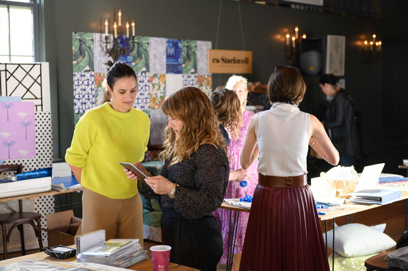 Sara Ruffin Costello shopping Paige Cleveland's collection of marbelized silks, leather and wallpaper