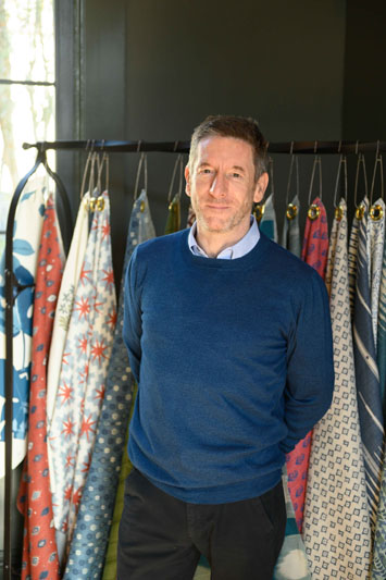 Peter Dunham in front of his namesake textile collection