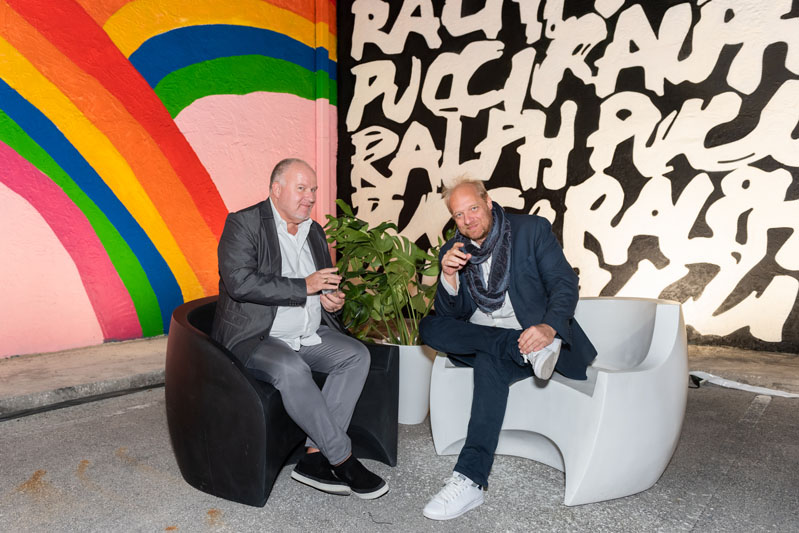 Guests mingled outside in the courtyard under Jean Charles de Castelbajac's murals.