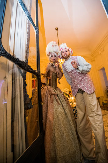 Guests posed with two costumed stilt walkers.
