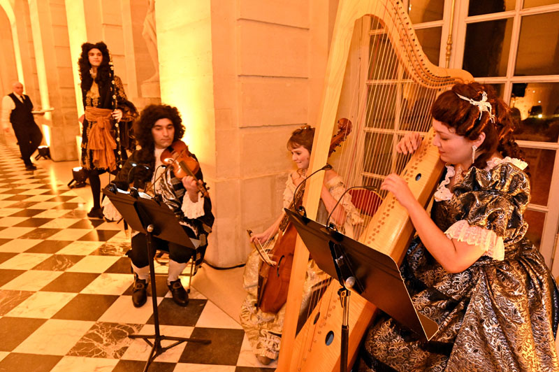 A Baroque musical trio played period instruments.