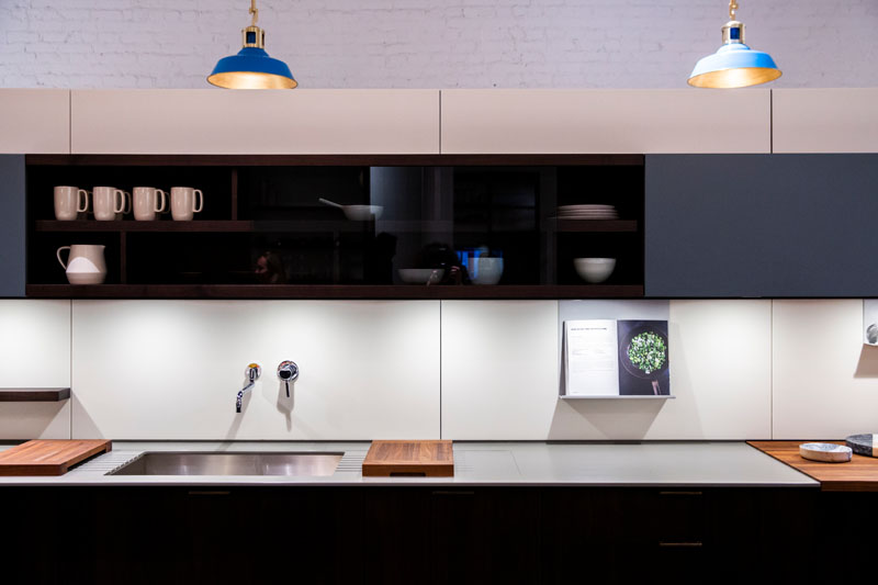 Mac pendants from The Urban Electric Co. hang over a Henrybuilt kitchen.