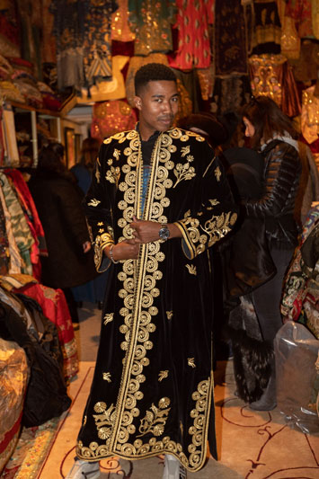 ASID NY Metro Chapter emerging professionals chair Keith Jones looking regal as he shops for a kaftan