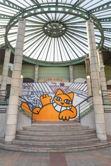 Street art could be seen throughout the surrounding areas of the flea market. This mural welcomes visitors at the entrance.