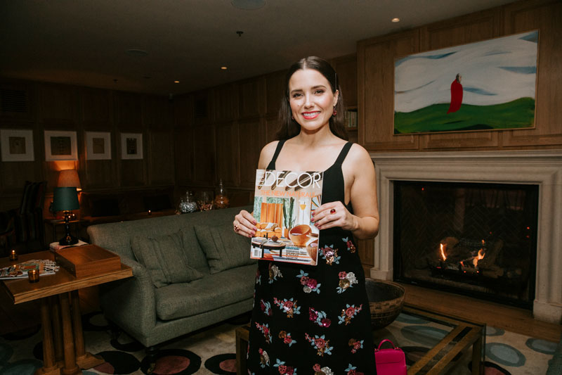 Sophia Bush holds a copy of the March issue of Elle Decor, which features her home on the cover.