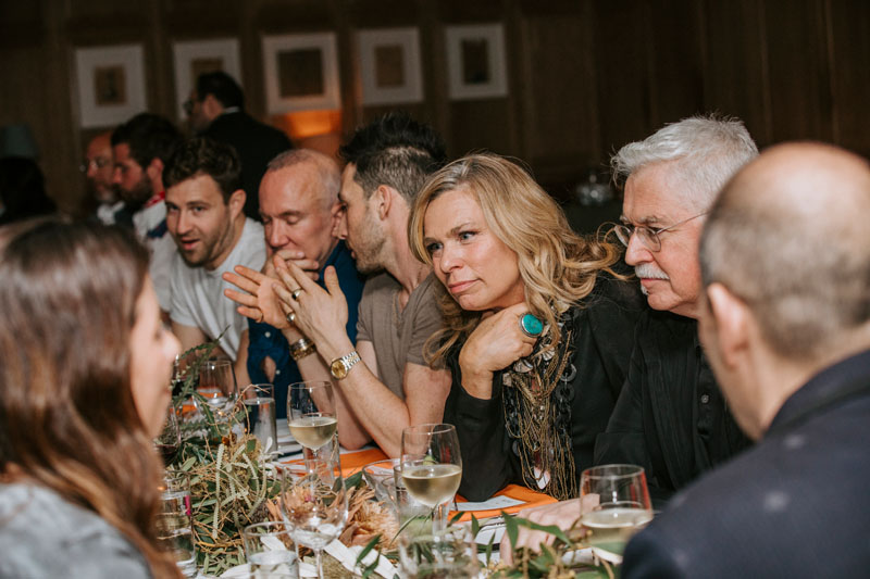 Guests enjoying conversation during Elle Decor's March issue celebration dinner