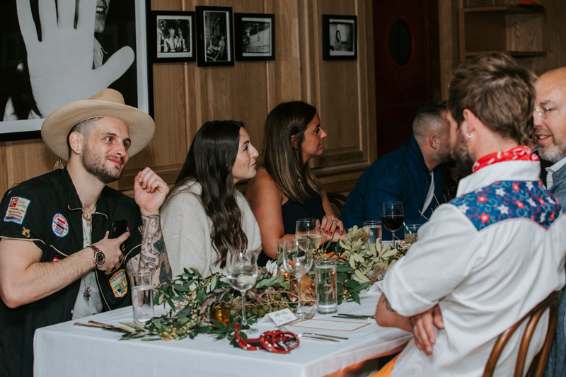 Nico Tortorella and other guests enjoying conversation during Elle Decor's March issue celebration