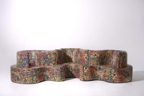 Floribunda leather in Multi covers a sofa