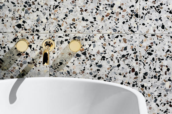 "Bond Solo Series Volume Controls with Knob Handle, Bond Tub Spout, Arcos Freestanding Bathtub and Portlandia Terrazzo Mezzo 16"" x 16"" Tile in Rockport Honed"