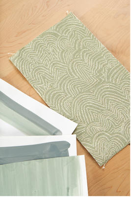 Linear Cloud fabric in Sage is a perfect way to bring some nature into your home