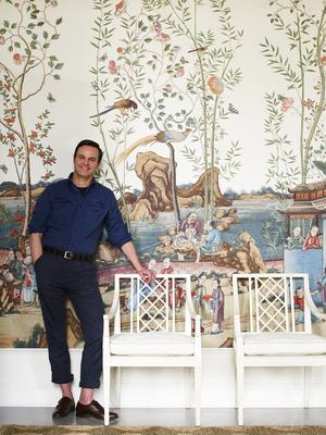 Mark D. Sikes with his Myrtle Dining Arm Chairs