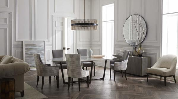 Ada Dining Chairs around the Modern Oval Dining Table