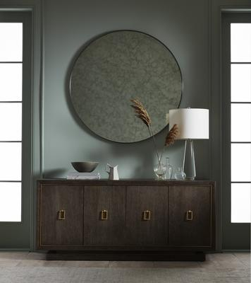 The Astor Round Mirror over the Emmerson Buffet