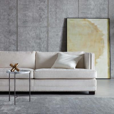 The Keaton Shelter Arm Sofa with a Seville Pull-up Table