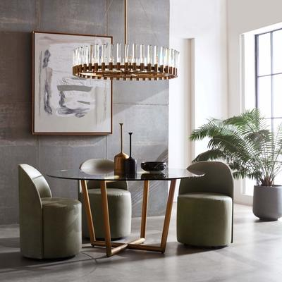 Margaux Dining Chairs surround a Modern Round Dining Table