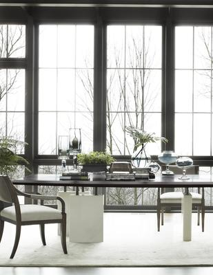 Saber Leg Dining Chairs surround a Block Dining Table