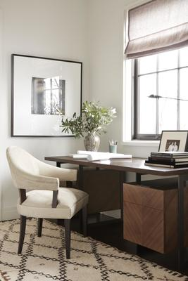 A Spoonback Dining Chair sits in front of the Barstock Desk