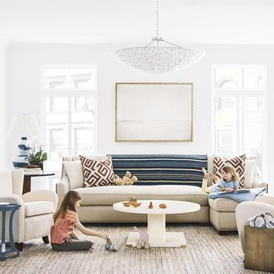 A living room by Bunny Williams featuring the Belinda Chandelier