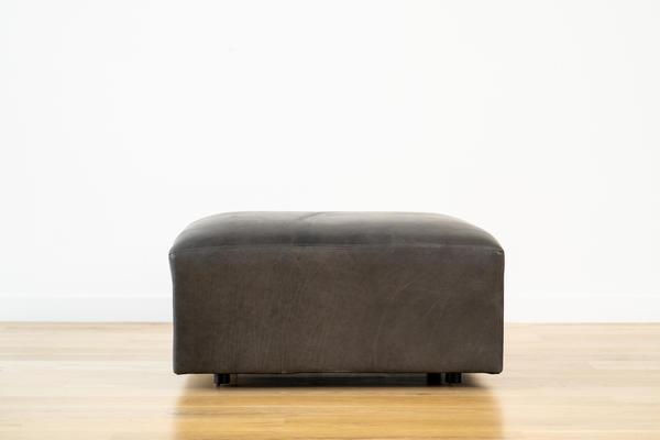 Linden Ottoman in Charcoal leather