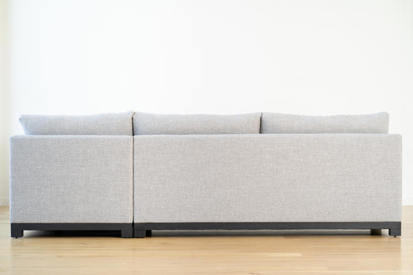 Mapleton Bumper Sectional in Gray linen and Charcoal oak