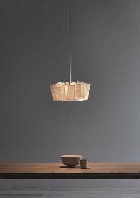 The Anders light is sculpted from layers of banana fiber, which is draped and stitched around the central light.