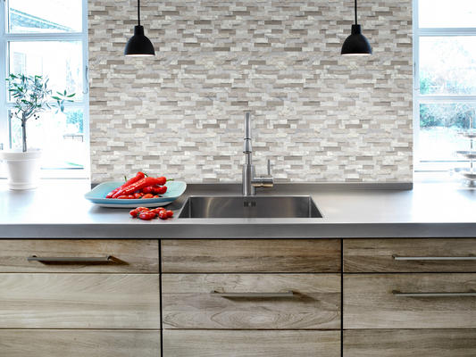 Feature is an easy-to-install groutless stone mosaic with a unique three-dimensional texture.