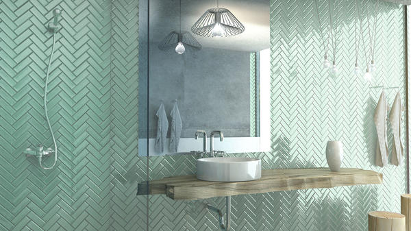 Irish is a large-scale, fashion-forward glass mosaic in a herringbone pattern with a glossy finish.