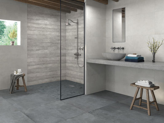 The glazed ceramic Rift offers a natural stone look in a plank size.