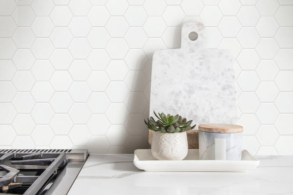 The clean, natural design aesthetic of the unglazed porcelain mosaic Source is amplified through its neutral color palette.