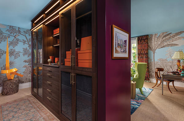 Laren Walk-In Closet in Flint with LED lighting and glass doors   Designed by Kevin Isbell; photography by Nickolas Sargent of DBA Sargent Photography