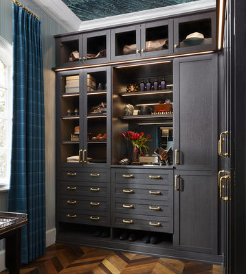 Laren Walk-In Closet in Hazelnut with LED lighting and glass doors   Design by Doniphan Moore Interiors; photography by Lisa Petrole