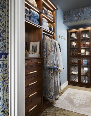 Laren Walk-In Closet in Chestnut with LED lighting and glass doors   Design by Michelle Nussbaumer; photography by Lisa Petrole