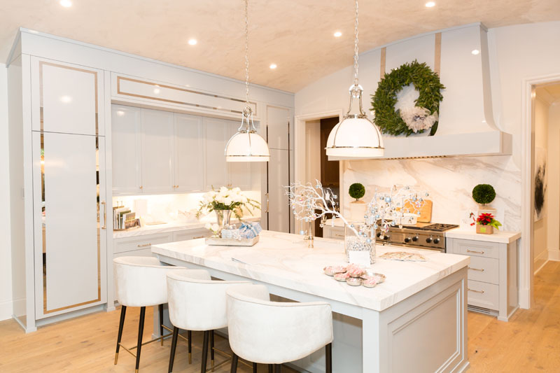 The showhouse kitchen was designed by The Jane Group with custom cabinets by Bell Cabinetry, countertops by Temmer, faucets by Renaissance Tile & Bath, and appliances
