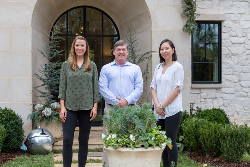 Steve Kamin of Hartstone (center), with Lucinda Bray and Kristi-Ann Wilson of Floralis Garden Design