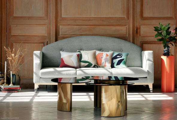 The most contemporary piece in the collection, the Hébé coffee table was designed as a trio, with one large model and two small ones so that each owner may invent a unique and suitable composition. Visually striking with a brushed finish on brass bases, the set features smoked glass tabletops, creating a striking contrast of materials and inspiring long evenings spent with friends.