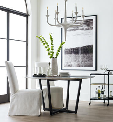 Julia slipcovered chair, Modern Round dining table, and Flora chandelier