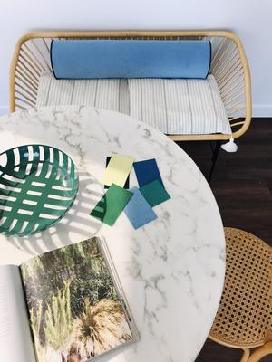 A bench seat cushion upholstered in Ultrasuede Lake, with Ultrasuede Cerulean piping, by interior design blogger Cassandra Lavalle of Coco Kelley