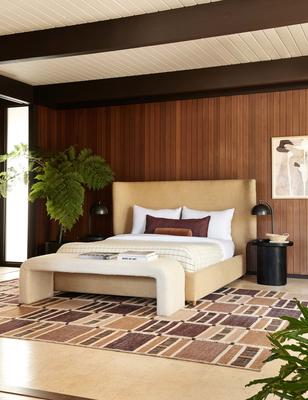 Anni rug by Nina Freudenberger, styled with the Valen platform bed in Wheat, Tate bench in Cream, andLuna side table in Black